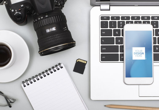 Top View Mockup of Laptop and Smartphone with Camera and Notepad