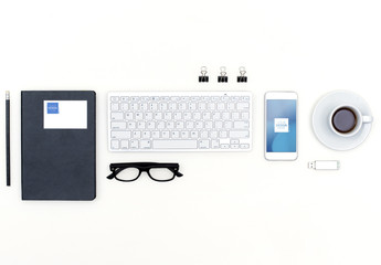 Top View Mockup of Keyboard, Smartphone, Business Card and Accessories