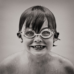 Boy Grinning While Swimming