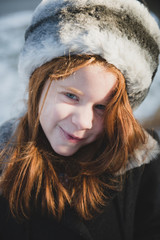 Young girl out in the snow