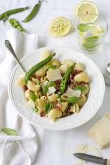 Pasta with pea and bacon topped with fresh parmesan