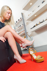Lady trying on shoes in shop