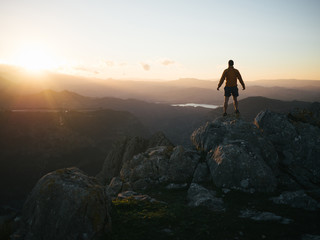 Man watching sunset from top of el chorro mountain