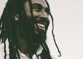 Smiling Young Man with Dreadlocks