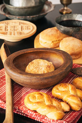 Rustic decorated table with bread and wine