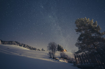 Cottage in the Alps at night
