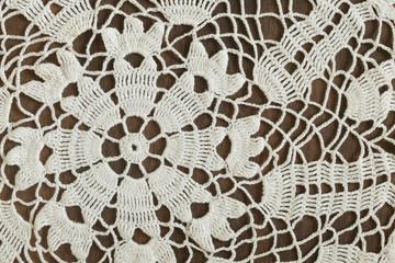 Detail of vintage crochet doily on dark background