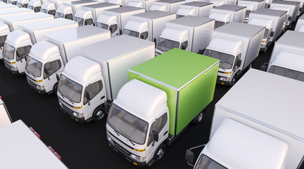Group of White Delivery Trucks with One in Green Color