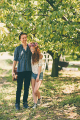 Happy Couple in an Orchard