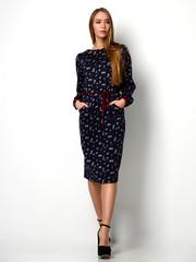 Young beautiful woman posing in new fashion blue pattern winter dress full body