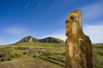 South America, Chile, Rapa Nui, Isla de Pascua (Easter Island), lone monolithic giant stone Moai statue illuminated with moonlight at Tongariki