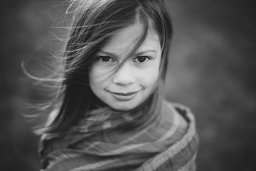 Black and white portrait of girl with windswept hair