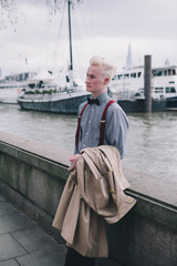 Fashionable young man next to the river Thames London.