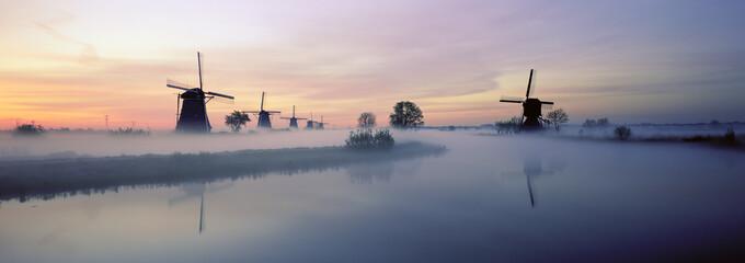 Netherlands, Europe, Holland, Zuid Holland, Row of Windmills and canal, Kinderdijk