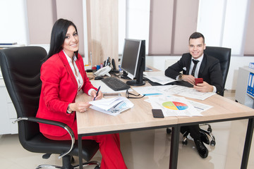 Businessman And Businesswoman Having Discussion In Office