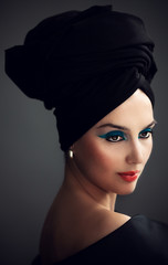Woman with the black turban on her head.