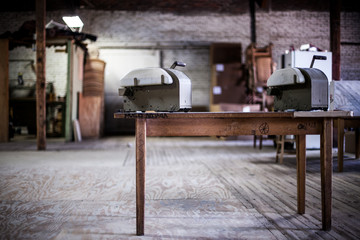 Table with machine atop in workshop warehouse