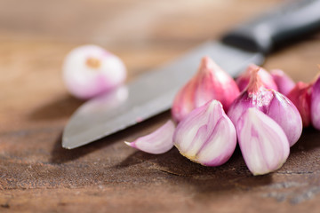 Slice shallots and knife on wooden background for cooking,spice an herb,food ingredient