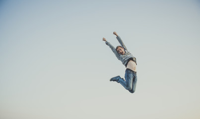 Young man jumps in air