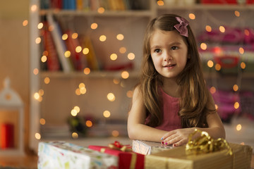 Child sitting with christmas presents