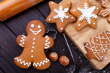 Christmas bakery. Homemade gingerbread man decorated with icing, close up. Festive culinary and New Year traditions concept
