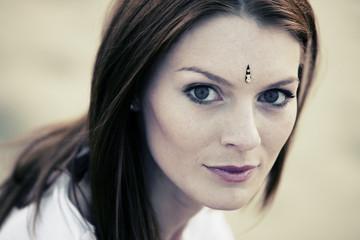 Portrait of beautiful woman wearing Indian bindi