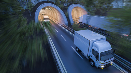 Various Commercial Vehicles Moving through Tunnels