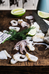 Preparing squid on a chopping board for a recipe.