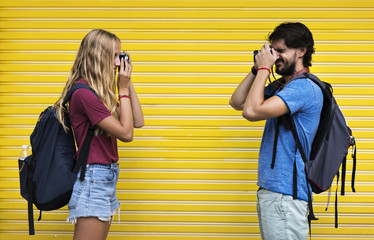Couple taking photos of each other