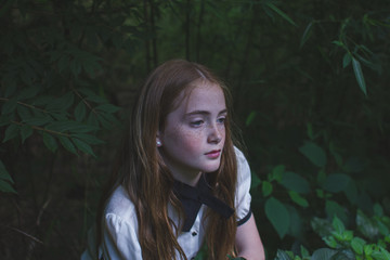 Young girl in woods