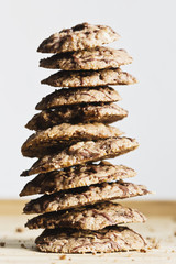 Stack of chocolate covered espresso cookies on wooden board
