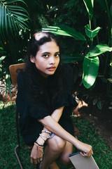 Beautiful Indonesian Woman Sitting in the Garden