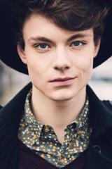 Headshot of a smirking young man