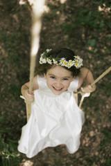 Child swinging in nature