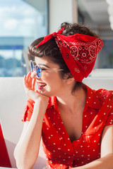 Portrait of young rockabilly girl smiling.