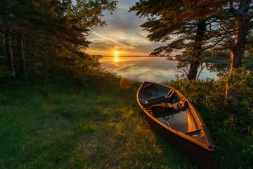 Empty canoe at sunset