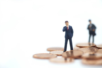 Miniature people: small figures businessmen