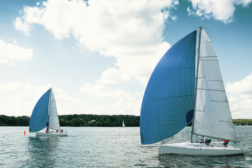 Sailing yacht race, regatta. Sailing boat. Recreational Water Sports, Extreme Sport Action. Healthy Active Lifestyle. Summer Fun Adventure. Team athletes participating in the sailing competition