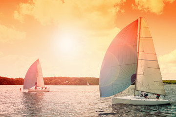 Sailing boat. Sailing yacht race, regatta.Sailboat at sunset. Recreational Water Sports, Extreme Sport Action. Healthy Active Lifestyle. Summer Fun Adventure. Hobby