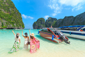 MAYA BAY, THAILAND - April  22, 2017: Crowds of sunbathing visitors enjoy a day trip boat ride to Maya Bay, one of the most beautiful beaches of Phuket province Thailand.