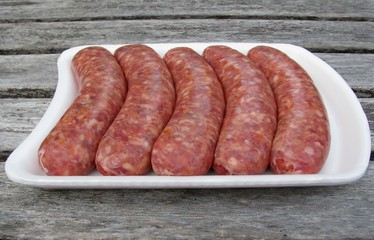 Fresh raw sausages on white Styrofoam tray