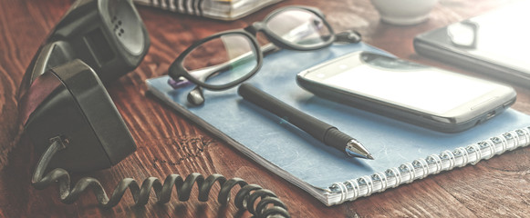 workplace. notebooks with pens and glasses lie on a wooden table. modern office