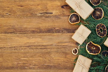 Christmas vintage background with fir branches on wooden table. Top view, copy space