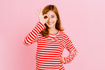 Fashion photo of young girl on pink background