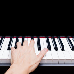 male musician hands playing on piano keys