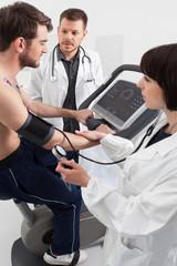 Doctor and nurse examination of cardiac stress test