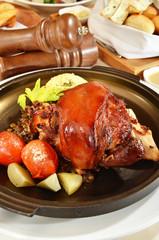 Roast pork knuckle on black pan
