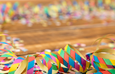 streamers and confetti wooden background