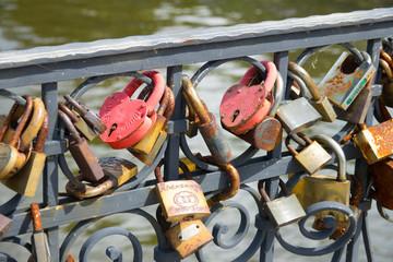 Love padlocks on the bridge. Wedding locks on a metal fencing. Love locks that couples hand on bridges to symbolize their true love.