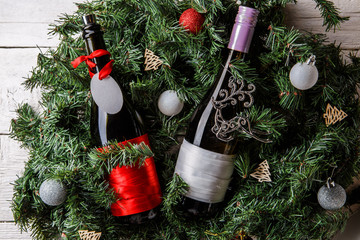 Photo of spruce branches with two bottles of wine, blank greeting card